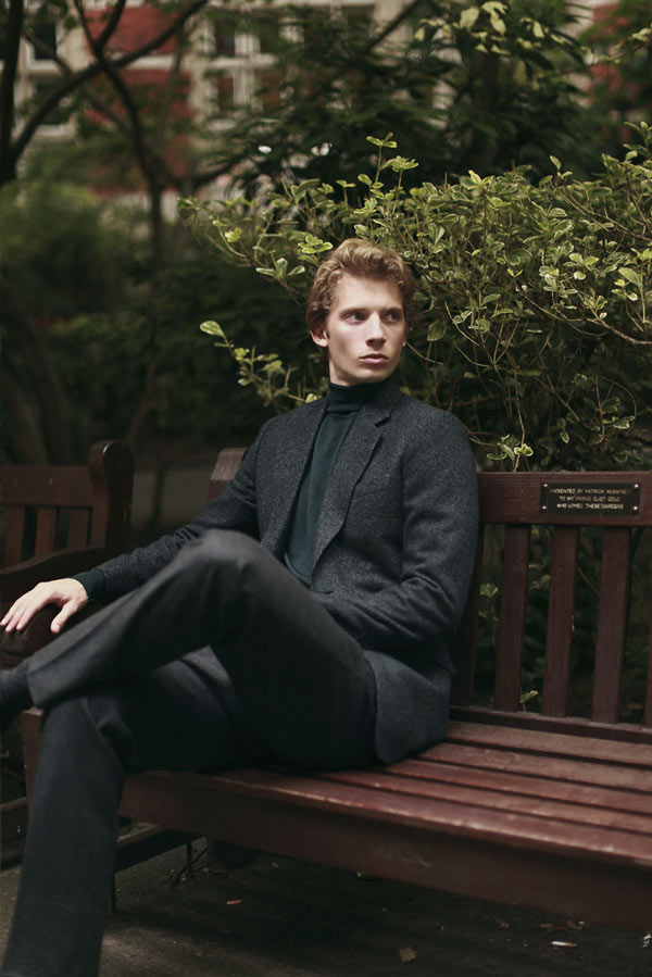 Young Male model standing in a bench